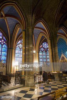 A Man Praying Inside Notre Dame Du Paris Cathedral, Paris, France