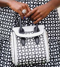 Lupita Nyong'o carrying an Alexander McQueen tote