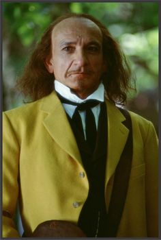The man in the yellow suit! He is a Nameless man no one knows his name. He is a very creepy tall man. He stole Jesse's horse and Went to go tell my Mom/Grandma where I was while Angus and I were on the boat. Ben Kingsley, Tuck Everlasting, Yellow Suit, Mom And Grandma, Tall Guys, Great Movies, The Man, The Outsiders, Actors