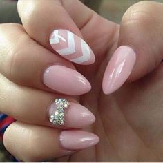 Baby Pink Almond Nails with a Studded Bow and White Chevron Lines.
