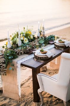 Beachside wedding tablescape | yellow and ivory floral centerpiece | sweetheart table | mini pineapples | rustic place setting | burlap runner