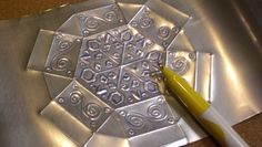 More tin work from aluminum cans; this one is hexagonal.