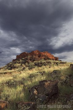 The Citadel by Mark Capurso, via 500px; Wupatki National Monument, Arizona (with petroglyphs on the boulder in the foreground)