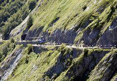 The Tour de France peloton descends the Col d'Aubisque under the gaze of a TV helicopter...