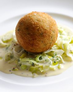These indulgent fish cakes from Dominic Chapman have a fantastic mix of smoked haddock, salmon and cod, with fragrant herbs and lemon zest all thrown into the mix. A thick layer of panko breadcrumbs ensures a crisp, golden exterior, and the creamed leeks make the perfect base to serve on.