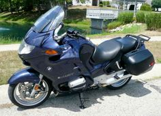 """Beautiful Titanium Blue 2002 BMW R1150RT. No other machine can compete with the BMW RT's perfect combination of comfort, handling, looks, performance and build quality. This bike has covered less than 19,000 miles since new. """"Just getting broken in"""" as they say for these oil-head boxer engines. These RT's came standard from BMW with countless features including: Torquey 1130CC Two Cylinder Engine - 6-Speed Transmission - Adjustable Suspension - ABS Brakes - E…"""