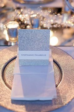 Menus on silver glitter paper, created by RedBliss Invitation Design, were wrapped with bellybands featuring each guest's name.