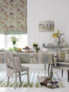 Blind in Hedgerow, price £38 per metre and Come By Pendant Lampshade, price from £77.50 and tablecloth made up from Voyage Country collection 3 fabrics.