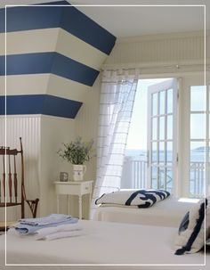 navy and white stripes perfect for this coastal bedroom