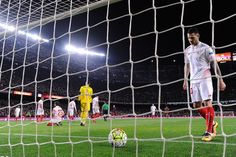 """Sevilla's midfielder Victor Machin """"Vitolo"""" (R) goes for the ball after Barcelona's defender Gerard Pique's goal during the Spanish league football match FC Barcelona vs Sevilla FC at the Camp Nou stadium in Barcelona on February 28, 2016."""