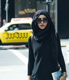 combining black in an outfit is one of the best ways to make a strong fashion statement and this hijabi does it well!