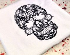 I like the lace idea. Mine would be, hibiscus, lace and skull though