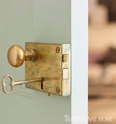New brass rim locks from Baldwin, distressed to look old, replaced hardware throughout this cool Greenwich Village apartment. - Photo: Emily Gilbert / Design: Jenny Wolf
