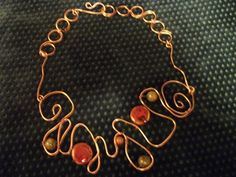 Copper wave necklace with ceramic and jasper stones. http://www.artfire.com/ext/shop/product_view/PigeonCreekSoaps/5825946/hammered_copper_wire_necklace_with_jasper_and_ceramic_beads/handmade/jewelry/necklaces/wire_wrapped