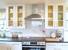 love the look of these painted glass cabinets- plus a how to on switching out ikea's glass with other.  jb  Paint the Backs of Kitchen Cabinets | Cape27Blog.com