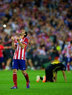 Juanfran of Club Atletico de Madrid celebrates victory during the UEFA Champions League Quarter Final second leg match between Club Atletico de Madrid and FC Barcelona at Vicente Calderon Stadium on April 9, 2014 in Madrid, Spain.