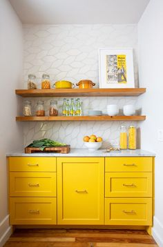 white and yellow bar // yellow kitchen // yellow cabinets // floating shelves // bar alcove