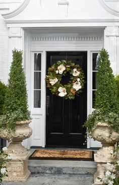 Our Magnolia Wreath is bursting with ultra-realistic white blooms emerging from deep glossy green leaves. Brimming with magnolias in every stage of growth, from the bulb to the full flower head, artistically arranged on a grapevine wreath base.