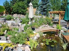 We put a koi pond complete with a bridge in this outdoor living space. The landscaping really compliments the deck and hot tub, don't you think?