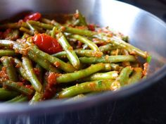 This traditional Greek green beans recipe (Fasolakia giaxni) will amaze you! Prepare these green beans the authentic Greek way with some sweet onions and fresh, juicy tomatoes, creating an all time favorite vegetarian dish!