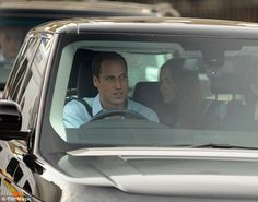 Proud: Prince William managed to get his son in the car seat, right the first time! He then drove his wife and son away from the The Lindo Wing and headed to Kensington Palace. The quintessential photo of the new family ~ momma in back watching the new baby's every move while pops drive the new 3-some home.