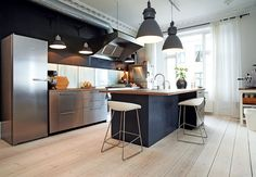 Danish tv personality Timm Vladimirs kitchen is coloured in a lot of different grey tones, and a beautiful mix between rustic and elegant furniture and interior.