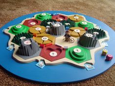Custom 3D Settlers board made from scrap plywood -- I like the Lego bandit