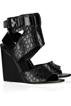 Perfect for your Winter wardrobe — just add tights — and a classic Summer sandal staple, this Alexander Wang lizard-embossed wedge is a steal. Alexander Wang Natalia Embossed-Leather Wedge ($232, originally $580)