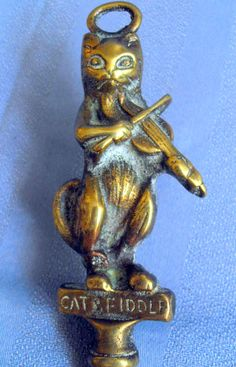 B7026 £SOLD (Jan 2015). A vintage, possibly antique, brass toasting fork with ball joint fork and figural finial in the form of The Cat and Fiddle.