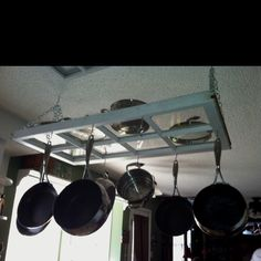 My pot rack that me and my husband made for our new house out of an old window! Now to finish cleaning the pots. Decor, Pot Rack, Country Cottage Kitchen, Wrought Iron Decor, Old Window Frames, Tuscan Decorating, Diy Window, Pot Hanger Kitchen, House Plant Pots