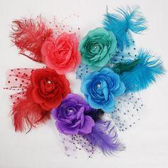Adornos para el pelo del bebe. Divertidos tocados con plumas velo y flor en varios
