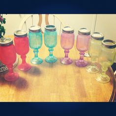 DiY colored redneck wine glasses. Dollar tree mason jars and candle sticks. Glue together then mix Elmer's glue with food coloring and paint a thin layer on clean dry glass. Then bake in oven for 10 min at 150 degrees :)