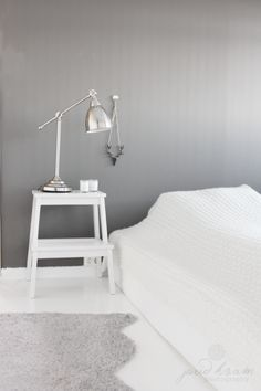 grey bedroom with bedside table & lamp