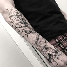 black and grey snake and tree tattoo sleeve by @junnionunes