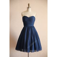 Vintage look polka dots tulle dress in navy blue color. Strapless sweetheart neckline with detailed ruched bodice. Puffy knee length skirt. This dress comes in…