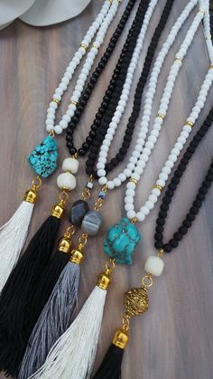 Tassel necklaces are here to stay! This one is black and white will compliment your wardrobe all year round.  To make it I have used 6mm matt glass beads and combined them with a beautiful ivory jade gemstone, an ornate antique metal bead and a handmade tassel made with glossy yarn from India. Length: The options I give is the length of the beads from end to end. If you choose the shorter option you will have a final drop of around 20 and if you go for the longer option you will have a final…