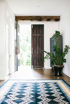 adding color: integrating cool tones w geometric statement rug.