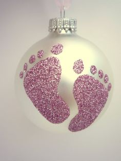 Dip babys foot in glue and then press foot onto the ornament. Then glitter the ornament. Can also use a bigger childs hand!