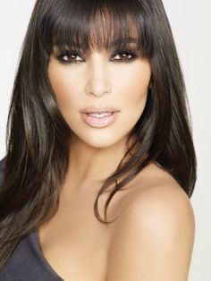 Straight bangs look Kim Kardashian - hate her. dig bangs and length.