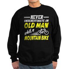 NEVER UNDERESTIMATE AN OLD MAN WHIT A MOUNTAIN BIK