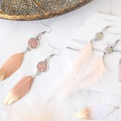 Pastel coloured summer jewellery with cute feathers and golden details