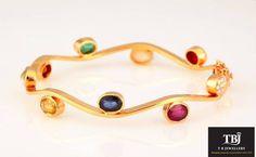 The Navarathnas dancing on your wrist. #tbjewellery #Goldenmoments #diamond #gold #girlslovediamond #jewellery #navarathna #bangle