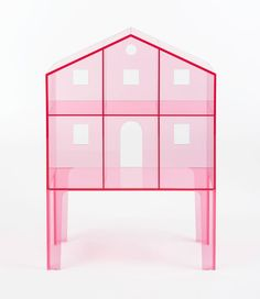 The latest addition to Kartell is a set of translucent, candy-coloured plastic and minimal doll's houses created by Fabio Novembre.