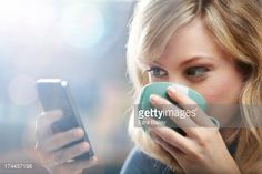 Stock Photo : Woman using phone and drinking coffee.