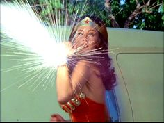 Lynda Carter as Wonder Woman stopping a bullet cold with her bracelet