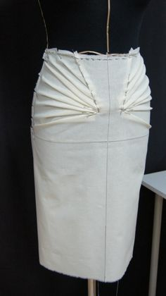 Great inspiration photo showing a skirt that has been muslined with inset pleated sections.