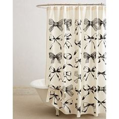"""Give your bathroom a classic vintage touch with our black and cream shower curtain, featuring alternating patterns of vintage bows. Measures 72"""" x 72"""""""
