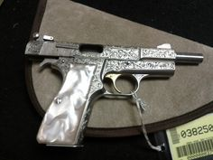 "Browning Hi Power Renaissance 9mm. I got to hold this beauty in my hands today. The engraving was beautiful. The gun is well-balanced. Truly a piece of art. This is my ""Holy Grail"" of guns. Yes, i almost bawled like a baby when I had to give it back to the salesperson."