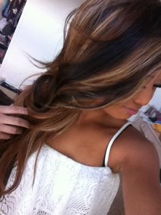 Brown hair with blonde highlights and dark brown/black lowlights.