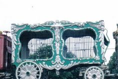 """This wagon is commonly referred to as the Toby Tyler cage for it's participation in the Walt Disney classic """"Toby Tyler."""" When these ornate carvings were put on this wagon is unknown as it was originally produced with no carvings. It is now part of the Circus World Museum collection in Baraboo, Wisconsin."""